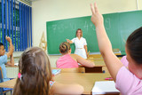 Elementary School Students at Classroom Desks