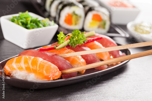 Poster sushi pieces with chopsticks