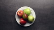 Hands putting plate with fruits on table