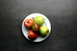 White plate with fruits on table
