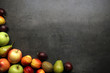Fresh fruits on table with copyspace, top view