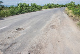 Fototapety Damaged road in the countryside