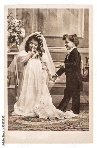 Vinatge photo portrait of little girl and boy in weding dressing © LiliGraphie