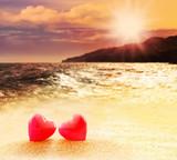 Fototapety Hearts on summer sunset beach