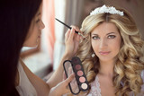 Fototapety Professional Stylist makes makeup bride on the wedding day.