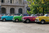 Fototapety Cuban coloured taxis in Old Havana