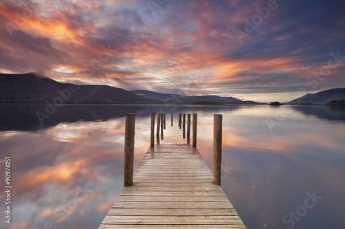 Obraz Flooded jetty in Derwent Water, Lake District, England at sunset