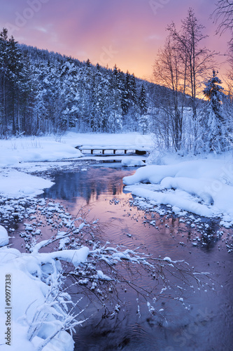 Obraz Sunrise over a river in winter near Levi, Finnish Lapland