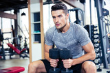 Man workout with dumbbells in gym