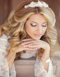 Fototapety Beautiful bride woman indoor portrait. Makeup and wavy hair styl
