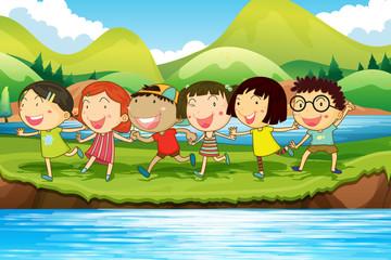 Children having fun at the pond