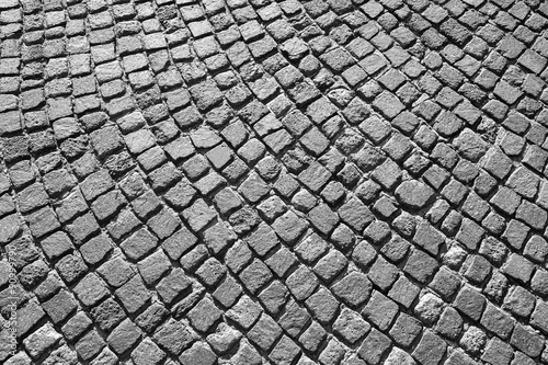 Gray granite cobblestone road pavement