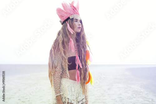 Boho Gypsy young women wearing stylish indian feather hat - 91061538