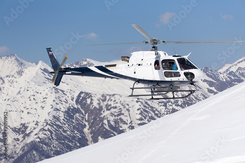 obraz lub plakat White rescue helicopter in the mountains
