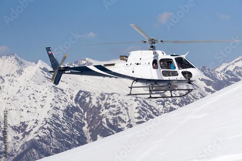 fototapeta na ścianę White rescue helicopter in the mountains
