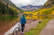 Cyclist at Maroon Bells in Fall