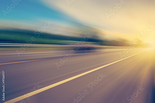 Fototapeta abstract empty asphalt blurry road and sunlight with space