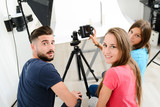Fototapety group of young photographer student on photography shooting workshop course indoor in a photo studio