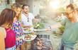 Obrazy na płótnie, fototapety, zdjęcia, fotoobrazy drukowane : group of friends making barbecue in the garden backyard