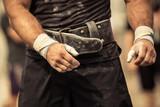 Bodybuilder girding on his bodybuilding belt poster