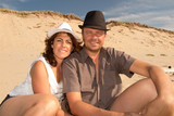 Couple with hat at the beach - 91321149
