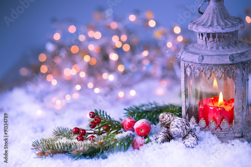 Christmas background - lantern with decorated  fir branch in cold snowy winter night