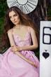 Obrazy na płótnie, fototapety, zdjęcia, fotoobrazy drukowane : portrait of a young girl in a pink dress as Alice in Wonderland