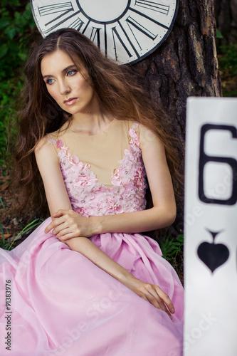 Zdjęcia na płótnie, fototapety, obrazy : portrait of a young girl in a pink dress as Alice in Wonderland