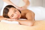 Fototapety beautiful woman in spa salon getting massage
