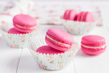 Fototapety Pink raspberry macaroons on white wooden background