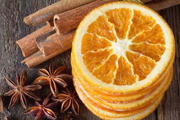 cinnamon sticks, anise stars and slices of dried citrus