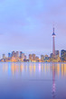 Toronto city dusk over lake with colorful light