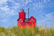red lighthouse in dune grass in Holland, Michigan