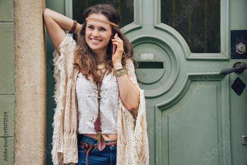 Plagát Happy woman wearing bohemian style clothes talking cell phone