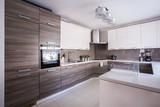 Kitchen furnished in modern design - 91520338