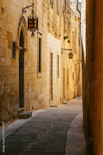 Fototapeta Ancient narrow maltese street in Mdina