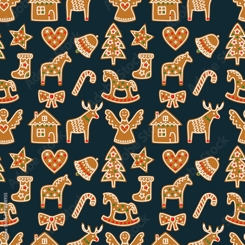 Materiał do szycia Seamless pattern with Christmas gingerbread cookies - xmas tree, candy cane, angel, bell, sock, gingerbread men, star, heart, deer, rocking horse. Winter holiday vector design xmas background.