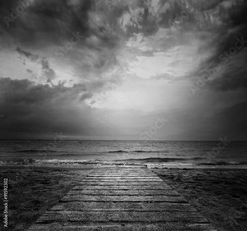 Bridge into the sea - loneliness concept in BW