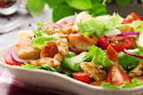 Delicious salad with chicken, nuts, egg and vegetables. - 91622703
