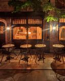 Night view of cozy restaurant in Bruges, Belgium