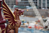 LONDON, UK - SEPTEMBER 17, 2015:  Holborn Viaduct dragon against of building site with crane poster