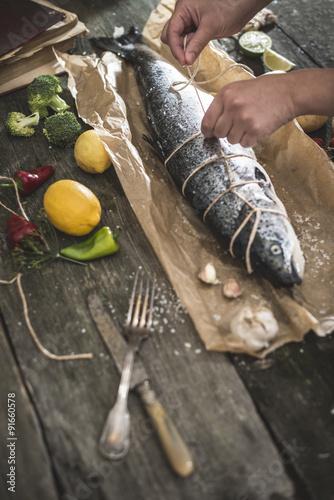 Canvastavla Tying a rope on samon fish