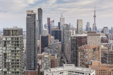 Cluster of high-rise buildings in Downtown Toronto on the background of Toronto sky.