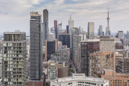 Cluster of high-rise buildings in Downtown Toronto on the background of Toronto sky