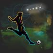 Football player shoots the ball