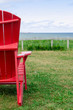 Red Adirondack chair at beach