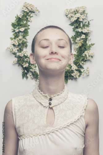 Poster beautiful bald-headed girl over floral background