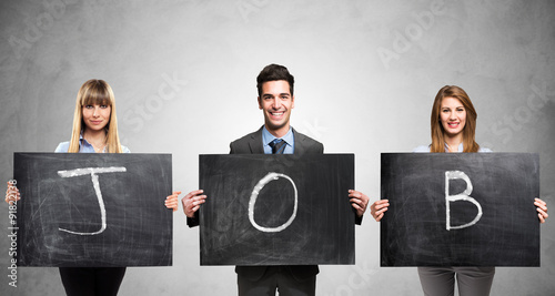 Foto Murales People holding blackboards with the word Job written on