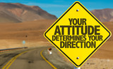 Fototapety Your Attitude Determines Your Direction sign on desert road
