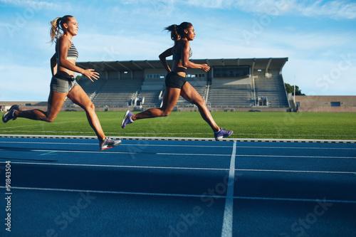 Juliste Athletes arrives at finish line on racetrack